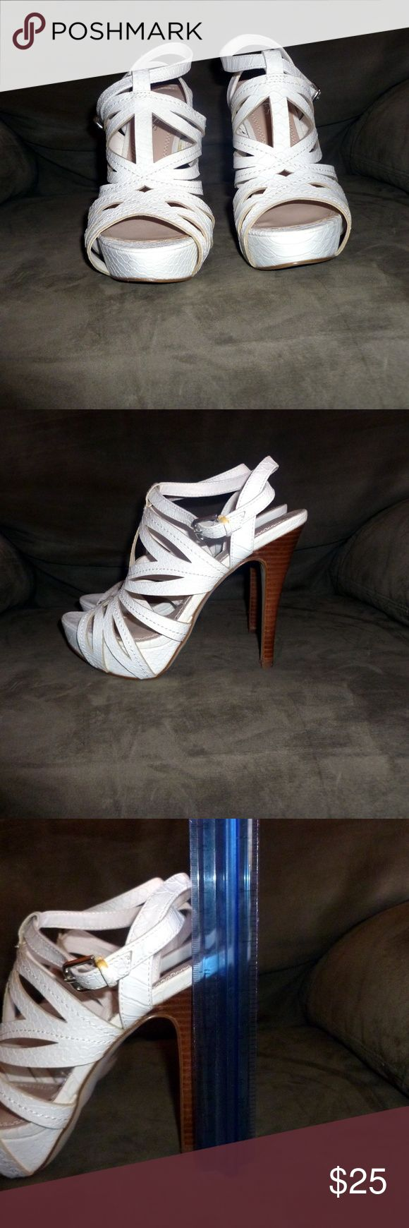Guess shoes White Guess high heel shoes in size 6 1/2, these are faux leather and have been worn approx. twice.  These are in excellent condition.  The heel measures 3 1/2 in and the platform measures 1 in. Guess Shoes Heels