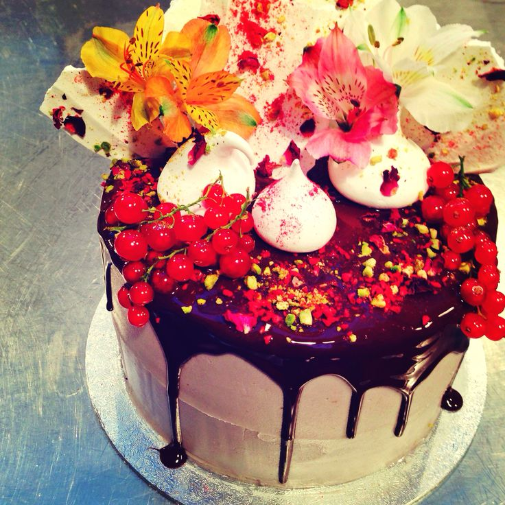 Victoria Sponge Cake with rosewater meringue kisses and shards, dried raspberries, pistachios and chocolate.