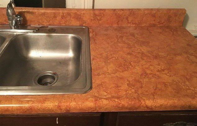 When you're SO over your laminate kitchen countertops this might be the most inexpensive way to dramatically transform them!
