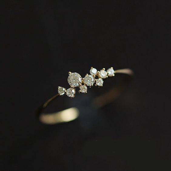 This delicate ring is set with grade AAA cubic zirconia. It is a perfect alternative to engagement ring. Small enough for daily wear or mix and match with other rings. Please note that this ring is very dainty and delicate! Metal: 14k solid gold Stone: Grade AAA cubic zirconia