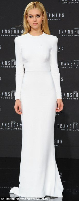 Polished: Nicola, 19, wore a stunning white floor-length gown which although fairly plain, accentuated her hourglass figure