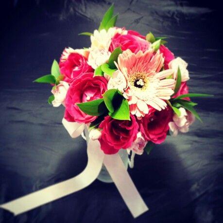 Pink handbouquet roses and gerberas