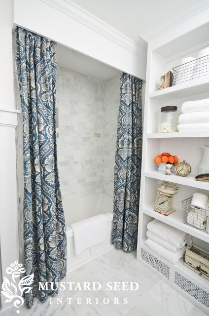 Miss Mustard Seed's Master Bathroom. Built-in cabinet and blue and white shower curtain...gorgeous!!!