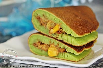 Apam Balik Pandan - This peanut-stuffed pancake is not something so special that you cannot get it from the market... nevertheless homemade is so effortless and you can stuff it generously! I like this recipe because it does not use yeast so no rest time needed for the mixture and ready for cooking as soon as the ingredients are mixed! Roz@HomeKreation