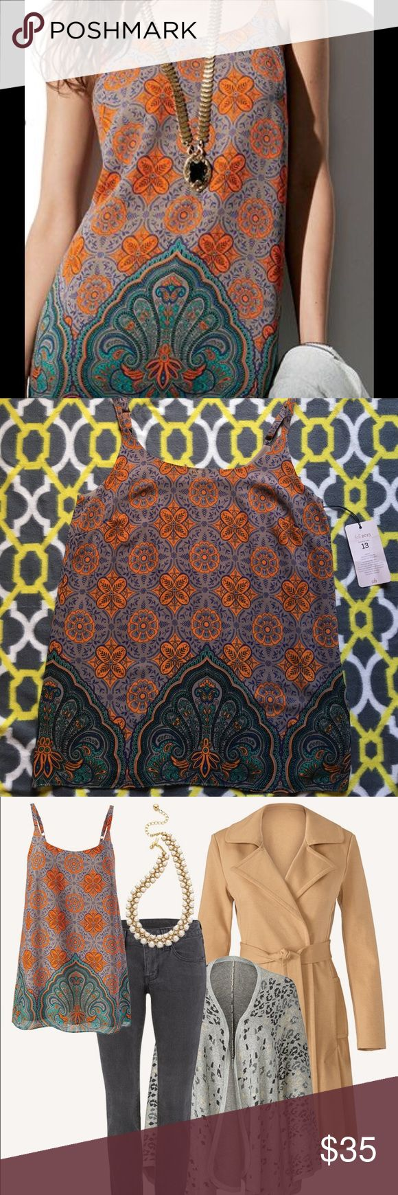 Women's Cabi Adjustable Spaghetti Strap top. From the CAbi Fall 2015 Collection comes this Arabesque Cami featuring adjustable spaghetti straps, fully lined, darts at bust, all in a beautiful geometric pattern of brown base with orange, bluish purple, green and touch of black.  Versatile piece for work or play.  Pair it with a structured blazer and skirt or dress it down with your favorite skinny jeans and a cardigan.  Tuck it in or wear it loose....it's got great flow, coverage and color…