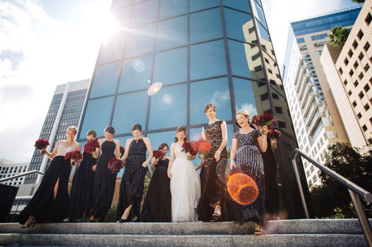 for her modern uptown wedding, the bride had her bridesmaids choose their own black evening gowns, and designed modern bouquets of red amaryllis, burgundy mini calla lily, black parrot tulips, burgundy astilbe, deep red roses, chocolate cymbidium orchids, pink mink protea, burgundy dahlias and begonia leaf