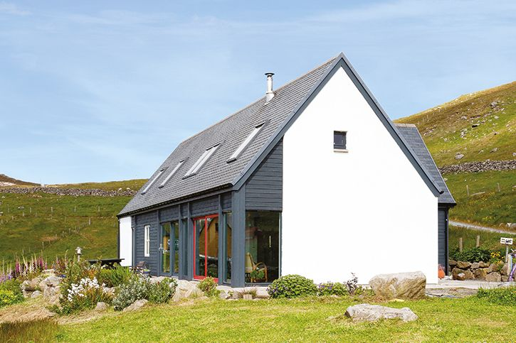 A Scottish home clad in white render and timber