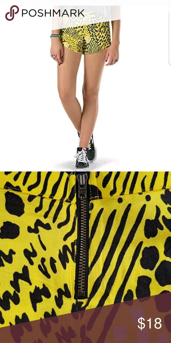 Vans yellow animal print shorts Vans  Animal print  NWT Animal print  Yellow  Black  White  Flowy Shorts  Zipper on back Vans Shorts