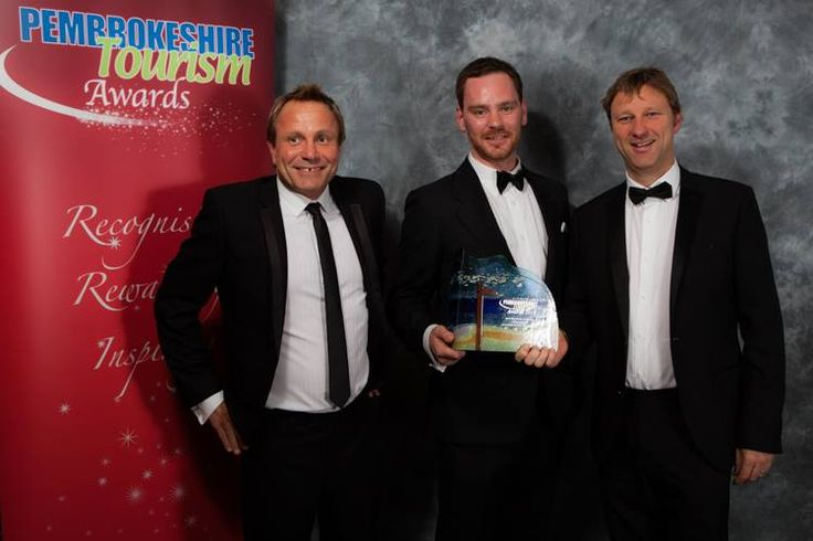 Dominic Subbiani, Gillan Williams and Tim Brace receiving the gold award for the Best Marketing Campaign at the Pembrokeshire Tourism Awards.