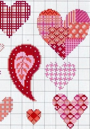 Pretty cross stitch hearts. Would make a cute valentines day decoration!