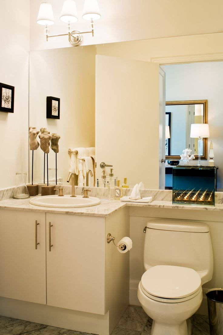 This tiny bathroom feels significantly larger thanks to the expanded viewpoint offered up by the wall-to-wall mirror. Mirroring an entire wall will amplify any space; hang one on a wall adjacent to a window and the reflection will open things up even more. — Kimberley Seldon, designer and owner, Kimberley Seldon Design Group