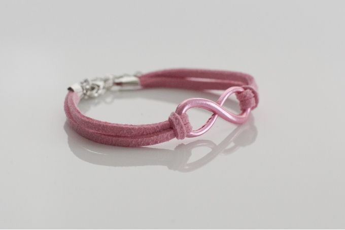 Pink suede-look infinity charm bracelet with pink charm by Haute and Tidy on hellopretty.co.za