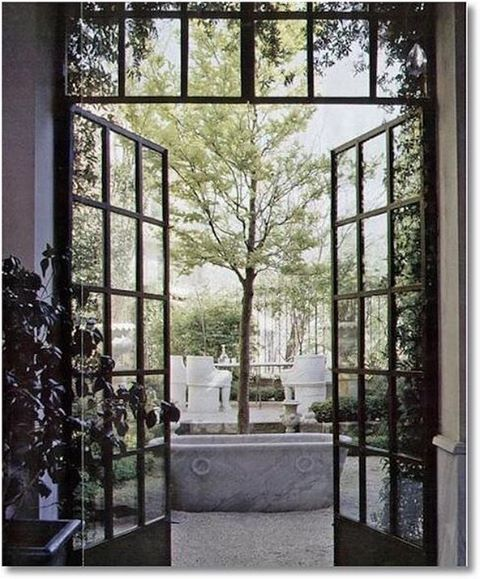 steel frame doors are still a big trend and they immediately add style to any space. loving this photo of a beautiful example leading to a stunning courtyard found on @melissa_penfold s Pinterest board.. dreamy! @horschinteriors #architecture #steelframedoors #keepitsimple #elegance