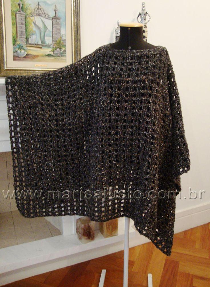 Poncho crochet a mão em lã.