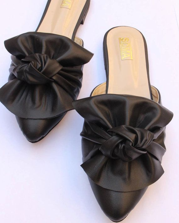 ffdb7d182 Flat leather backless slide mule shoes. Featuring a gently pointed toe and  a chic bow on the instep. Turnaround t…