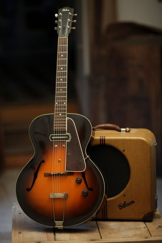 """1936 Gibson ES-150, first commercially successful """"Spanish body"""" electric, made popular by jazz guitarist Charlie Christian, who also popularized guitar as a lead instrument. Originally sold with the pictured amp, the EH-150."""