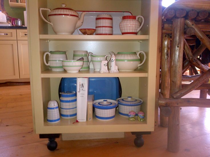 British Anchor Cottage china in the blue, red, and green pattern in cottage kitchen island.