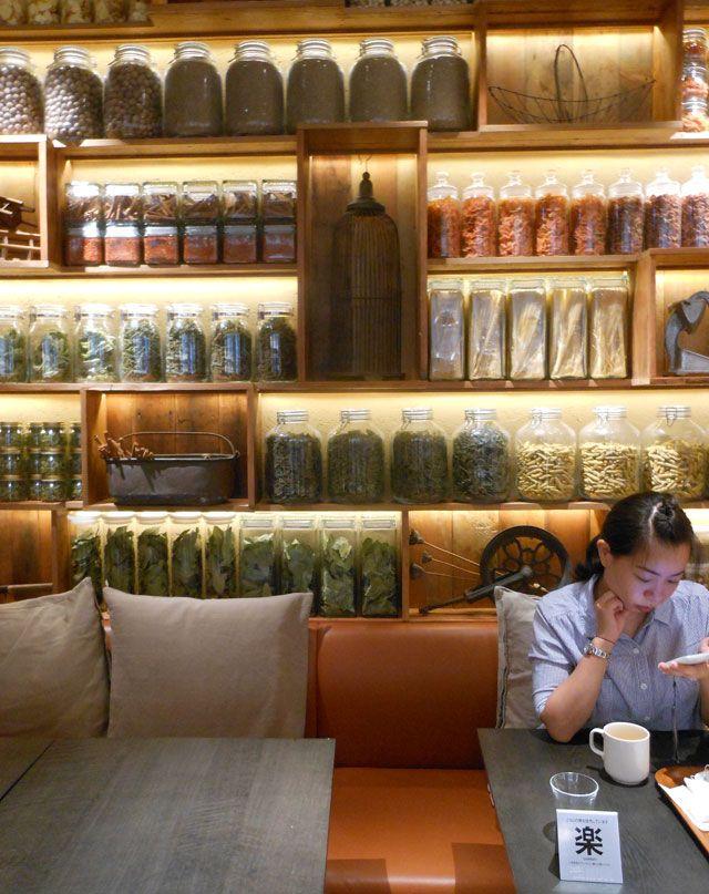 beautiful shelf merchandising at Cafe & Meal, MUJI, Aoyama by Japanese design firm Superpotato