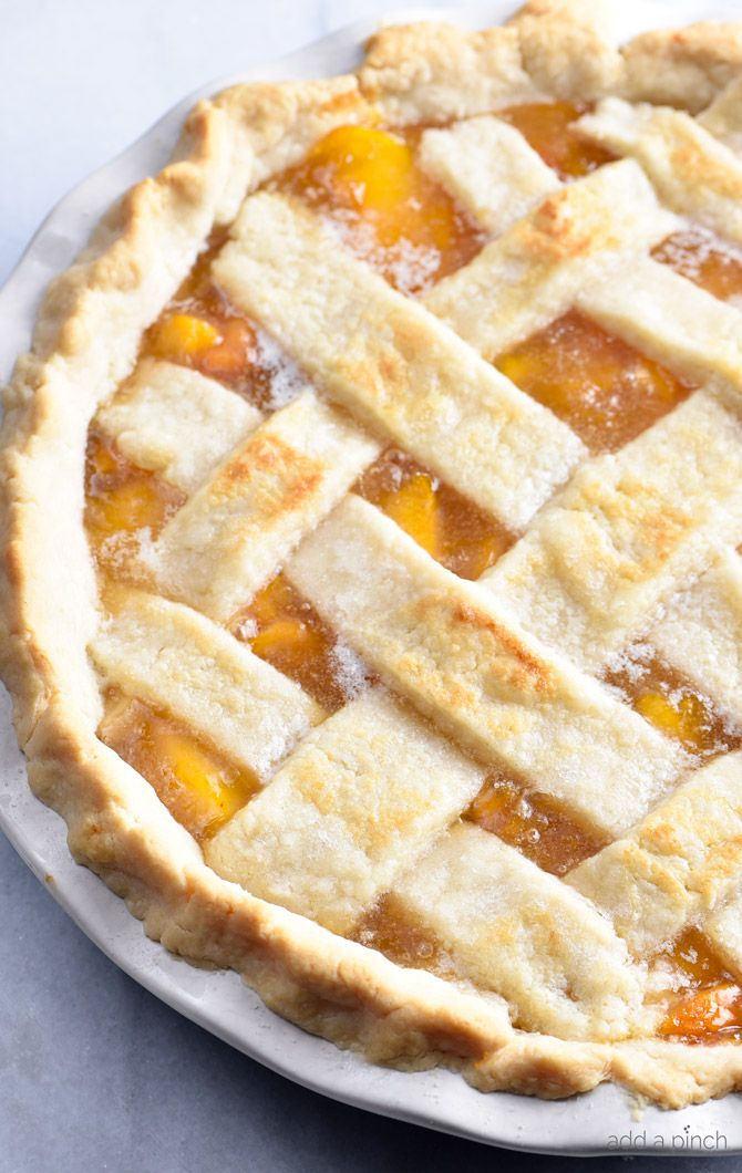 This Classic Peach Pie Recipe is a summer staple! Made with a lattice-topped double crust and filled with delicious peaches! Peaches are at their peak and I couldn't be happier about the situation. Seriously, I stalk the farmer's market about this time every year until the fresh peaches take up one whole side as you walk...