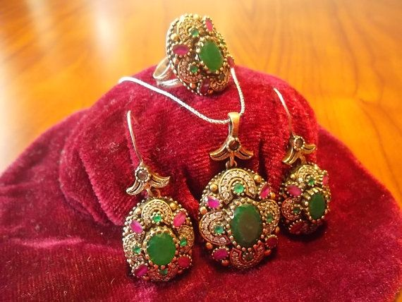 This fantastic jewelry set including two earrings, a ring and a necklace is made by Turkish handscraftmen inspired from Byzantine and Ottoman Empire Era. This set is made of real 925 sterling silver and rubies, emeralds and zirconia stones as shiny as real diamonds are fitted on the set. Total weight of set is 48.2 gr.  You can gladly use this ring for a wedding ceremony, graduation party or for a diner you need to be dressy.