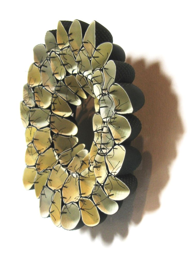 Niki Stylianou brooch - made with rubber gloves