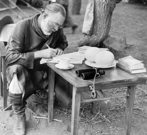 Ernest Hemingway drinking coffee. Well, there might be a little kick added......