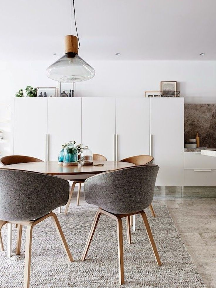 We like mid century modern but with a little upholstery to keep it from being too spare. This chair is almost right. Legs too spindly? Top 10 Modern Round Dining Tables ♥ Discover the season's newest designs and inspirations. Visit us at  www.moderndiningtables.net #diningtables #homedecorideas #diningroomideas @ModDiningTables