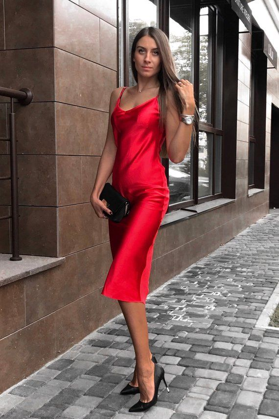 09b14af2659a Shimmer with every step while wearing this elegant red silk slip dress. Cut  from a