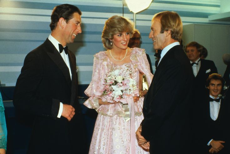 (Original Caption) Melbourne, Australia: Princess Diana and the Prince of Wales share a joke with Australian comedian Paul Hogan at a gala performance in Melbourne, April 14th. via @AOL_Lifestyle Read more: https://www.aol.com/article/entertainment/2017/03/30/old-photos-princess-diana-prince-charles-viral/22019148/?a_dgi=aolshare_pinterest#fullscreen