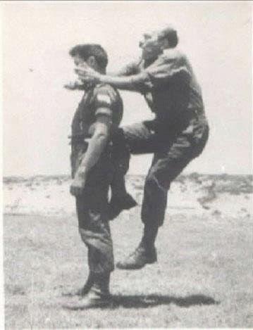 Imi Lichtenfeld, founder of Krav Maga practicing moves on soldier