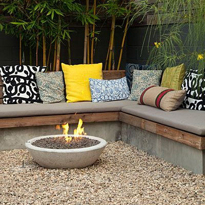 Concrete & wood patio seating + concrete fire bowl.