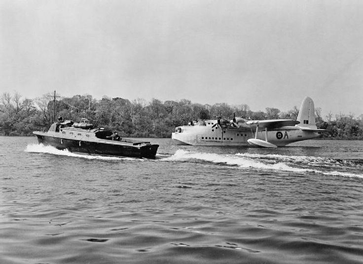 A peaceful scene at Castle Archdale in Northern Ireland on 20 May 1943, as a seaplane tender passes a Sunderland of 201 Sqn. The censor has removed all trace of the aircraft's fuselage-mounted ASV aerials. Photo by RAF official photographer Mr. H. Hensser. Royal Air Force Coastal Command, via the Imperial War Museum.