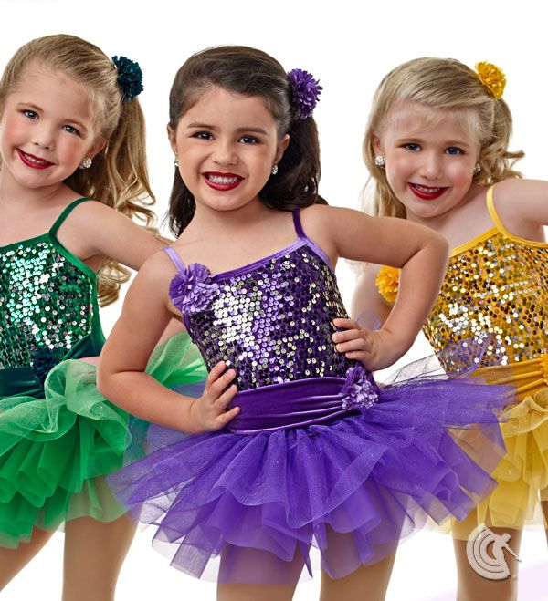 Curtain Call Costumes® - Always Together Stretch velvet leotard with sequin mesh bodice overlay and binding and flower trim. Attached glitter tulle and tricot tutu with gathered sash and flower trim. INCLUDES: flower barrette. Troupe price: $65 AUD - $70 AUD
