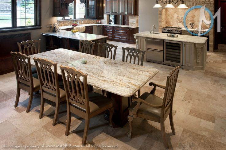 The table, island, and main counters all feature New Colonial Dream, creating a common theme throughout the kitchen.