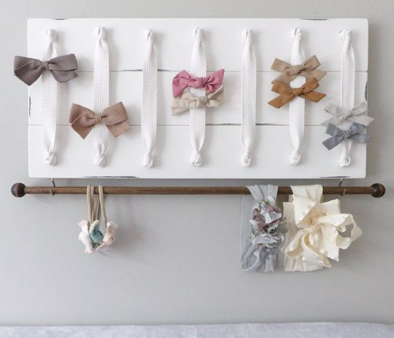 Brand New Listing! Large white bow organizer & headband holder. Turn you daughters bow collection into a work of art with this original, handmade organizer. Its the perfect way to both organize and display your bows and headbands beautifully in any nursery, girls room or bathroom. Each solid wood plank is hand-cut, painted and distressed. The solid white ribbon allows for a simple, elegant place to clip all your bows and barrettes. Along the bottom will be a 22 wooden headband bar or 11…