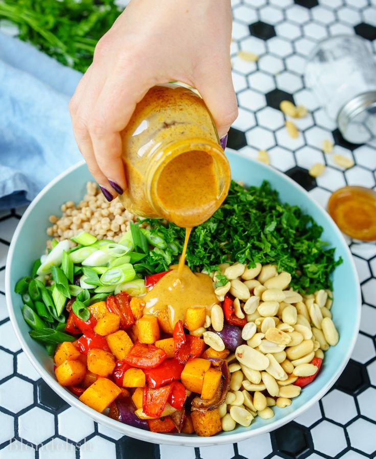 This Roasted Vegetable Couscous Salad with Peanut Butter Sauce is an amazing vegetarian recipe that can also be served as a side dish.  Its high fibers and vitamin content makes it filling and great with all diets.