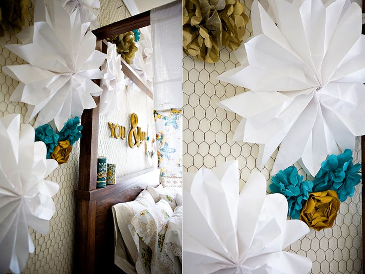 paper bag flowers - super easy - made these for my daughter's room in pink and white. i hung them from the ceiling with tiny clear command hooks and fishing line.