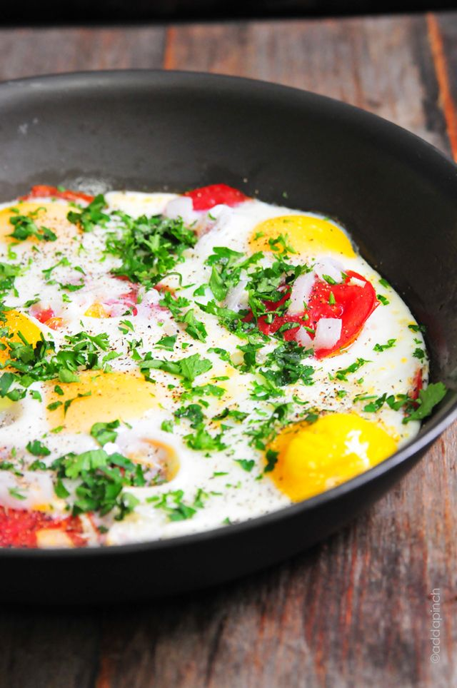Tomato Baked Eggs Recipe with onion garlic and monterey jack cheese..I added fresh spinach as well...this is a 5 star restaurant breakfast...I make individual servings in small cast iron pans.