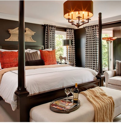orange and red are perfect accents for a brown room.