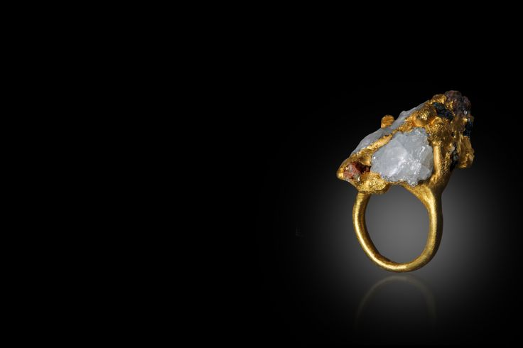 24 carat ring casted with rubies, citrine and quartz