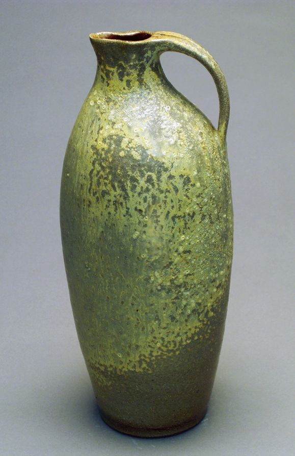 green ceramic jug or pitcher. Nice glaze. Would be perfect in the entryway...