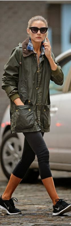 Who made Olivia Palermo's green jacket, black cat sunglasses, and sneakers that she wore in New York?