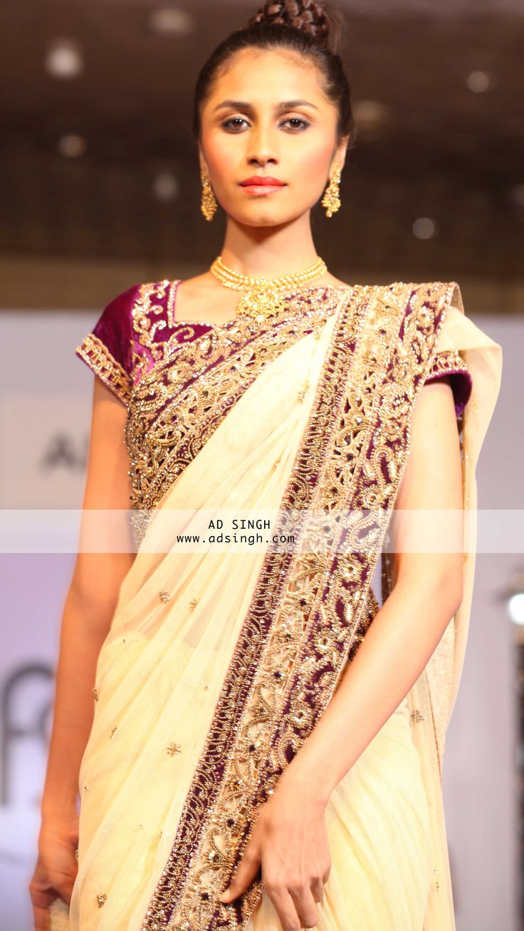 Cream with contrast maroon velvet fused border saree in intricate cut work and zarodisi highlights with swarovki dust and a velvet fused blouse. For more email : INFO@adsingh.com