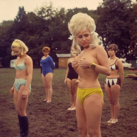 A colour still of Barbara Windsor as Babs after her flying bra incident in Carry On Camping.