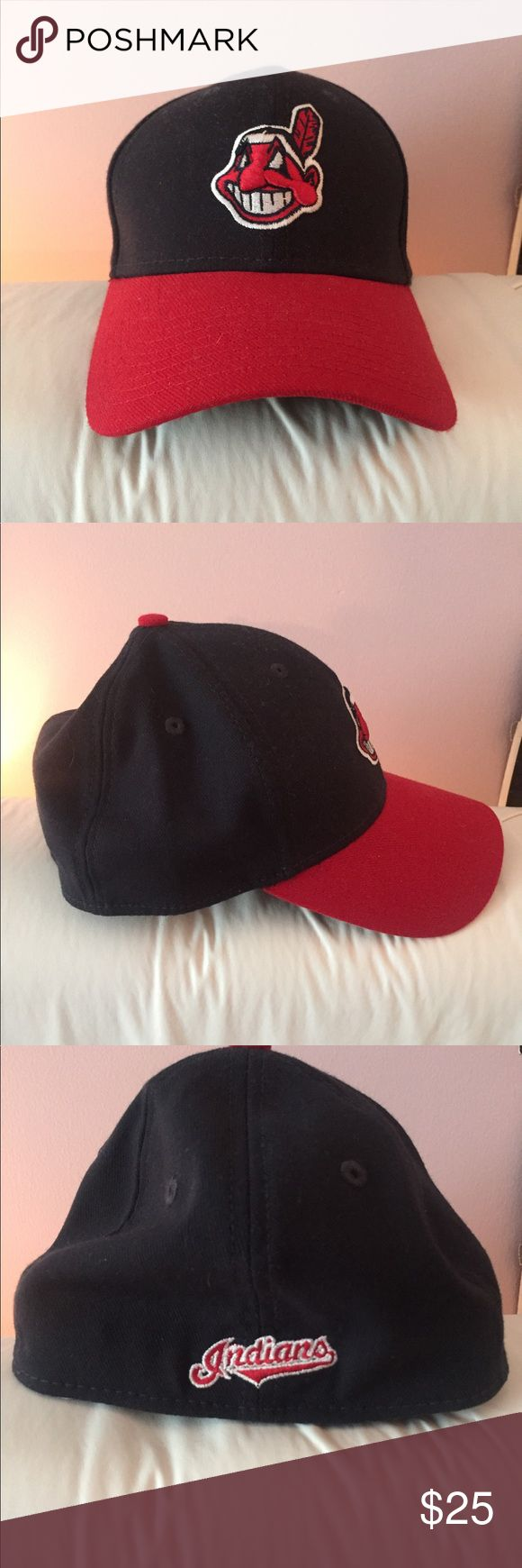 NEVER WORN Cleveland Indians Official Baseball Cap Official Cleveland Indians hat, navy blue with logo and red brim. One size fits most. Never worn! New Era Accessories Hats