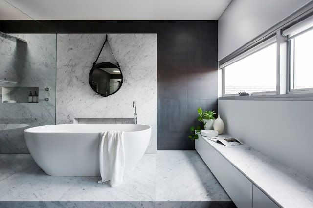 Minosa Design: Understated elegance creates a stunning bathroom.