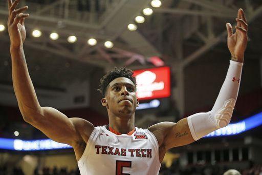 Evans scores 32, Texas Tech tops No. 22 Nevada 82-76 in OT