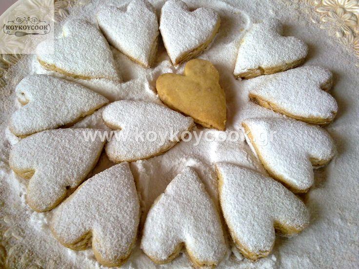 Edit description Greek traditional Christmas almond cookies (kourampiedes)