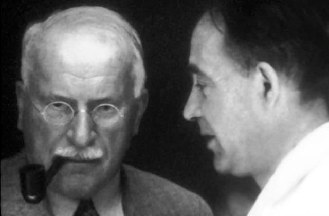 "This photograph of Carl Jung and Heinrich Zimmer was taken at the 1936 Eranos. The title of Jung's presentation that year was ""The Idea of Redemption in Alchemy."" Paul Tillich also lectured at the …"