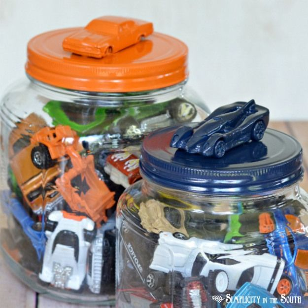 Love the lids for these. Spray painted Walmart glass containers with cars glued on top. Easy!